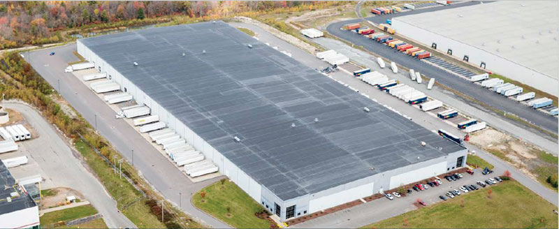 Aerial view of 400,000 square-foot facility at 68 Green Mountain Road. Shows the building and ample tractor trailer parking.