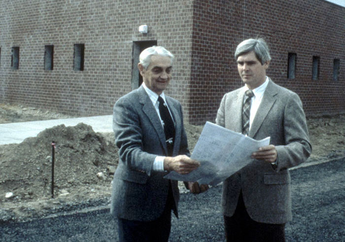 CAN DO President Kevin O'Donnell, right, reviews plans with CAN DO's first President Joseph Yenchko.