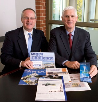 John  Spevak, left, chairman of the CAN DO Board of Directors, and  W. Kevin  O'Donnell, CAN DO president, hold some of the publications  that won  awards at the 2009 Northeastern Economic Developers  Association  Literature & Promotions Competition.