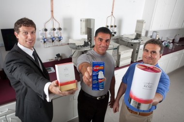 CAN DO Vice President of Sales and Marketing Joseph Lettiere, Wellness Formulations Vice President Anthony Cicini and Wellness Formulations President Thomas Cicini display some of the products created in Valmont Industrial Park by Troy Manufacturing and Wellness Formulations.